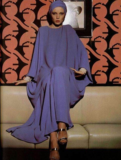 // Givenchy 1970s vintage fashion style loose kaftan style dress gown purple blue periwinkle turban silver shoes designer couture model magazine color photo print ad