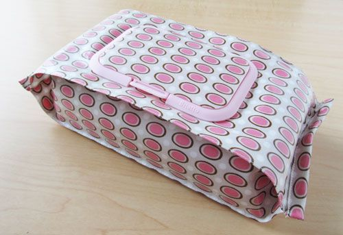 """DIY Baby Wipe Case Tutorial. You use a product called """"Bitatto"""" that you can purchase on eBay. They're refill caps for baby wipe cases. You will need laminated fabric 30cm×50cm cut,  30cm coil zipper, Bitatto, Glue."""