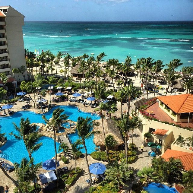 """There's a reason it's called """"grand"""" - Beacause the Grand Occidental Aruba truly is. And with 4 nights from $879, you'll be chillaxin' in high style. Promise. Expires 11/11/15. (Photo Credit: @cashstro215) #CheapCaribbean #Aruba #BeachDeals #Travel #OccidentalGrandAruba"""