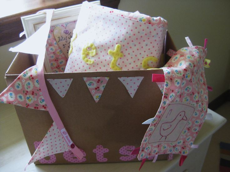 """Beautiful beadies """"baby hamper"""" In a lovely rustic box which includes a cot quilt, rag-tag, 3d picture frame with wooden personalised heart and 1m of double sided mini bunting all in matching soft quality fabric and can be made in a colour theme of your choice and personalised. £40 +pp."""