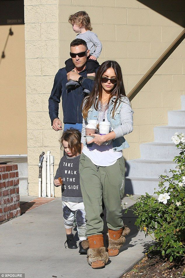 Happy families! Megan Fox and Brian Austin Green put aside their differences and put on an...