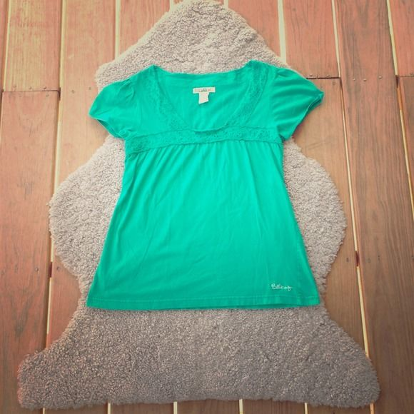 green short sleeve top lightly worn. no damages. soft. comfortable. simple. Billabong Tops