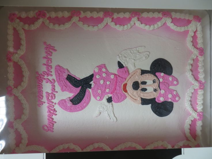 Adorable Minnie Mouse and swag drawn on our sheet cake