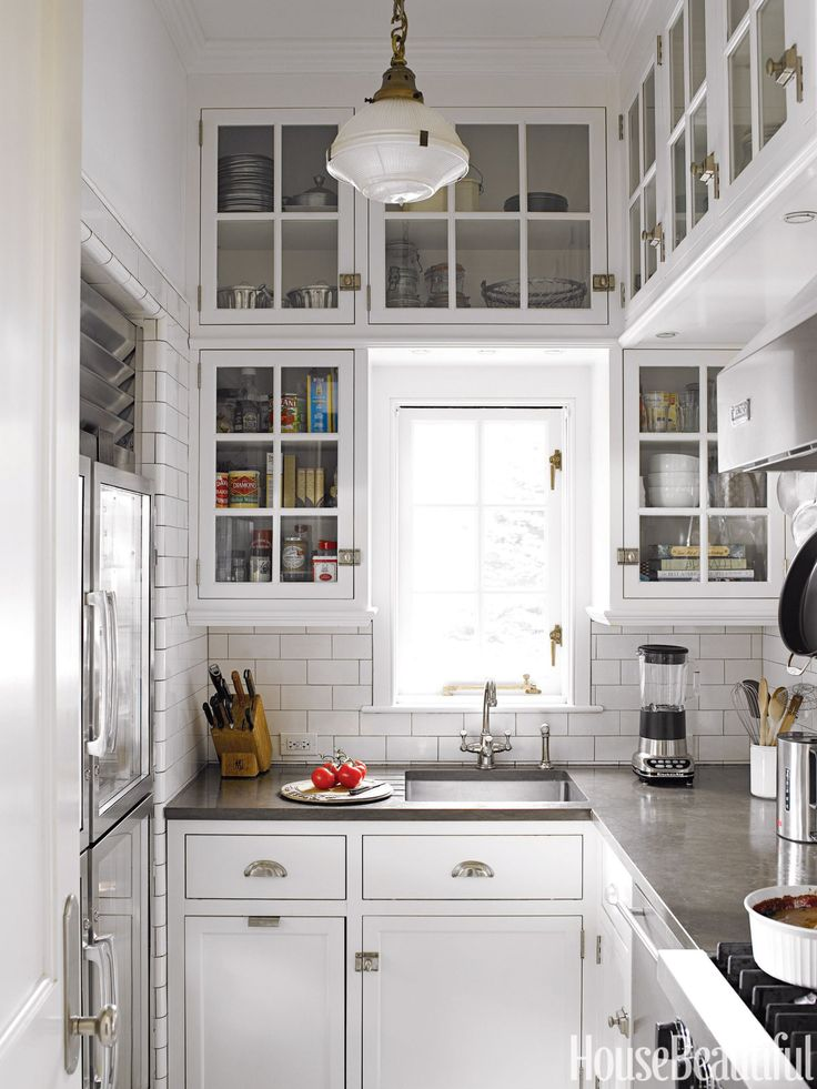 55 Inspiring Ideas to Update Your Kitchen - I love these high cabinets (I know, I'd need a stool get anything out of them so I'd just keep decorative things up there.)