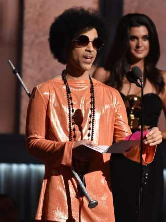 <p>Prince is a legendary performer and musical genius, but why does he get a standing ovation just f... - AP Photo