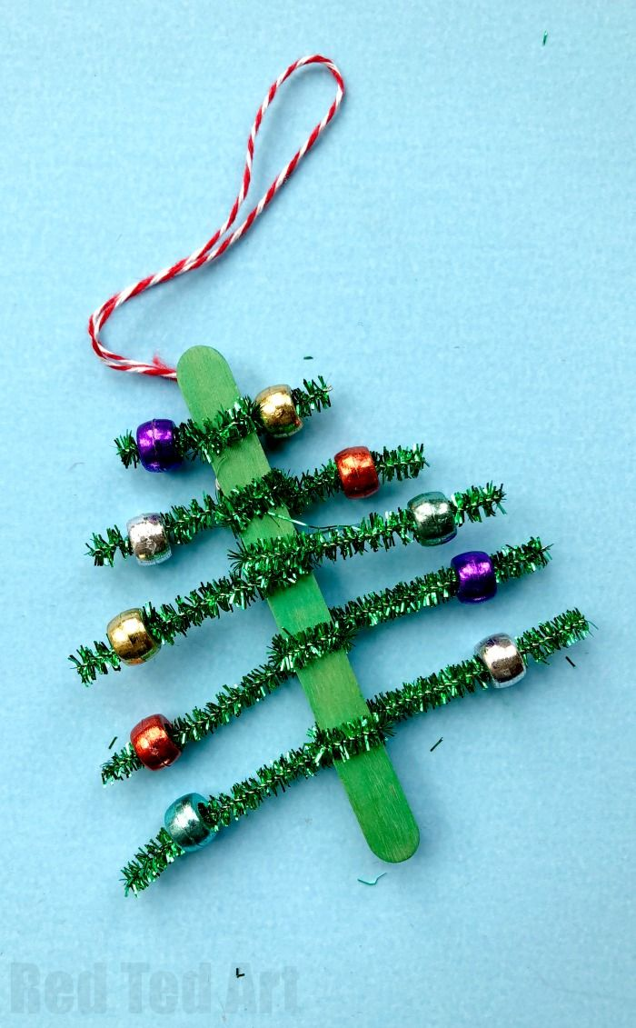 Pipecleaner Christmas Tree Ornaments - super cute and simple craft stick and pipecleaner tree ornaments. The kids will love to make these and they are great for fine motor skills. We made these at the school fair and they went down a treat! #Christmas #Ch