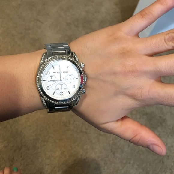 Michael Kors authentic watch Michael Kors authentic watch! Some signs of wear but this is a beauty! Box does not come with the watch. Bought for 275.00 from Macy's Michael Kors Accessories Watches