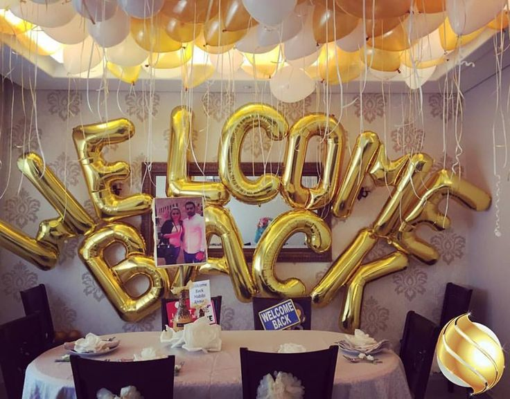 Balloon backdrop for a welcome back party decoration. Sparks