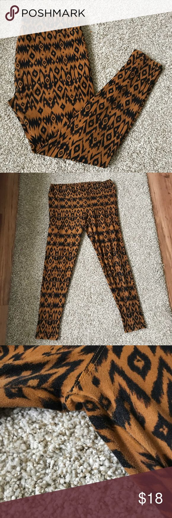 LuLaRoe Talk & Curvy Tribal Animal Print Leggings TC LuLaRoe cozy soft leggings in a brown and black Tribal Print, reminiscent of cheetah or animal print. Perfect neutral leggings! Tall and curvy size, washed per LuLaRoe instructions. Minor pilling on the leggings from wash and wear. ❣️ Reasonable offers are accepted! LuLaRoe Pants Leggings