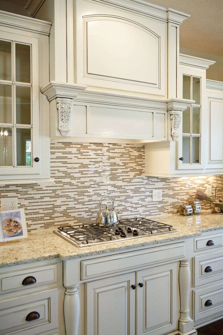 White Counters With Granite An Tile Backsplash