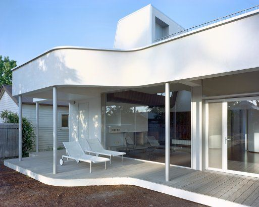 Solid protruding balcony with skinny steel columns - curved forms?