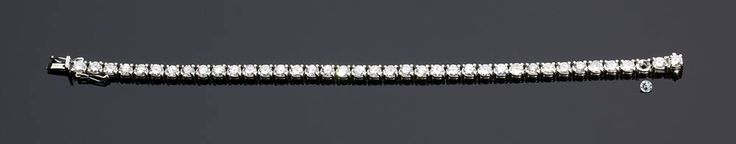 GOLD TENNIS BRILLIANT BRACELET; diamond bracelet set round brilliant-cut diamonds weighing 7.00 ct, G-H color, VVS-SI clarity. Italian assay mark 750. Weight 17.4 gr. Item condition grading: **** good.