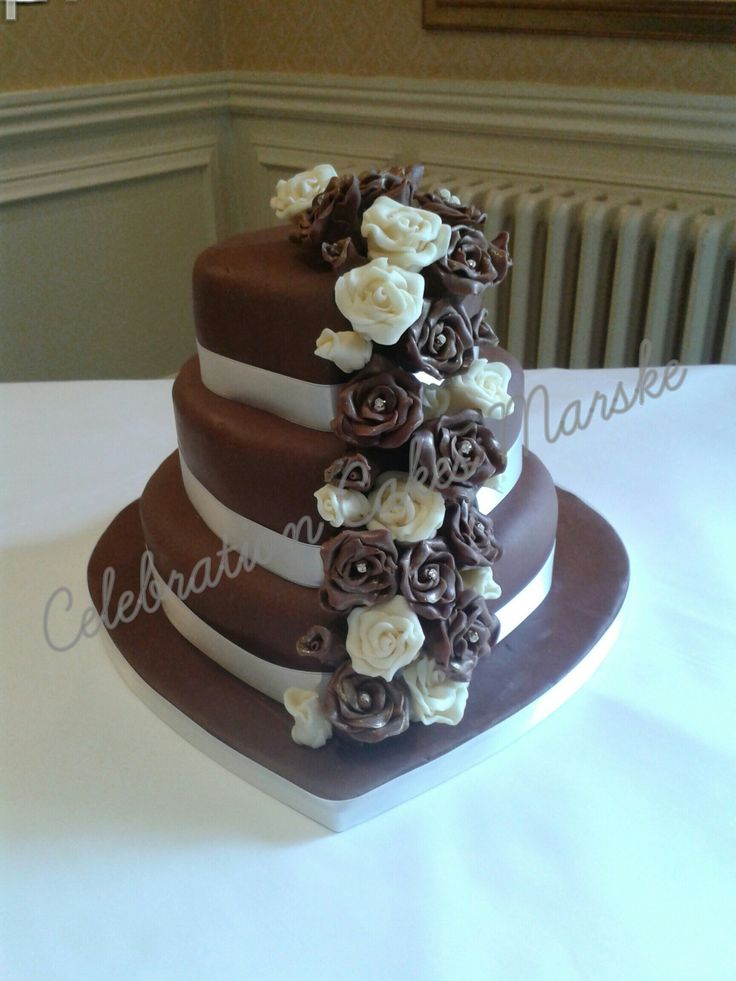 Chocolate and ivory heart shaped wedding cake decorated with handmade chocolate roses www.celebrationcakesmarske.co.uk