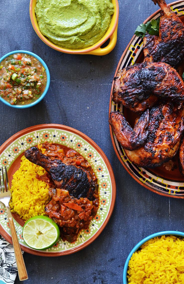 Grilled Cuban-Style Creole Chicken served with fresh salsa, guacamole and plenty of rice.