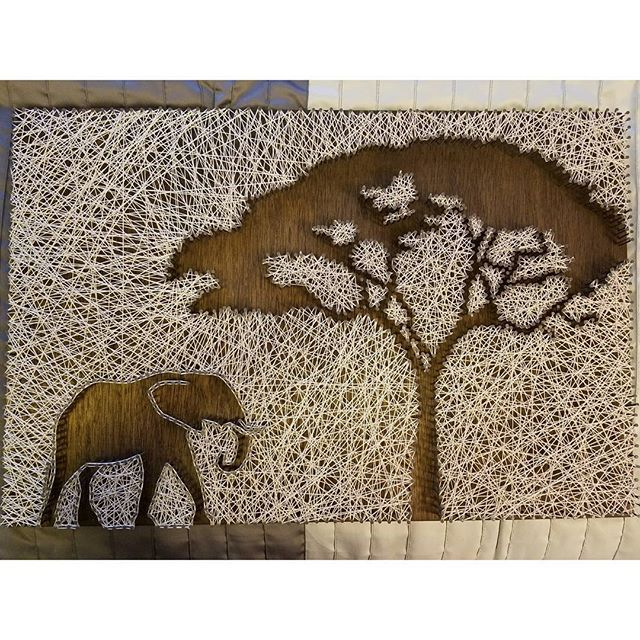 My latest piece is finally complete! I was a little nervous in the beginning but I love the way it came out! Another one for the #collection #stringart #homemade #diy #crafts #artproject #woodstain #african #elephant #tree #nature #silouette #negativespace #iwasnervous #positivevibes #loveit #trusttheprocess #nailedit #getit