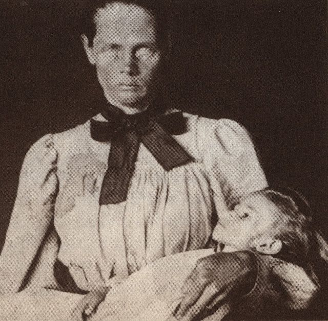 "A Boer woman with her dead child, the last of her children to die, photographed by Emily Hobhouse. An English activist, Emily spent six months in South Africa from January to June 1901 visiting Bloemfontein and six other concentration camps. Emily returned to England to campaign against ""a gigantic and grievous blunder caused by  crass male ignorance, helplessness and muddling."" Her militancy brought the scorn of the British people who called her hysterical, a rebel, liar, enemy of the…"