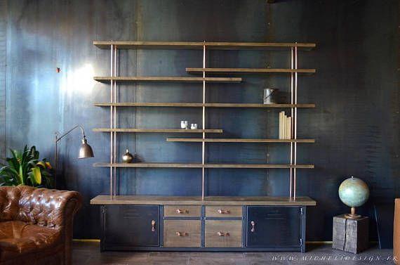 Création et Réalisation: MICHELI Design Fabriquée dans notre atelier, cette bibliothèque contemporaine avec caissons de rangement, vous séduira avec son subtil mélange entre lAcier, le Chêne et le Cuivre. Vous avez là, une bibliothèque bois métal qui saura se fondre avec goûts