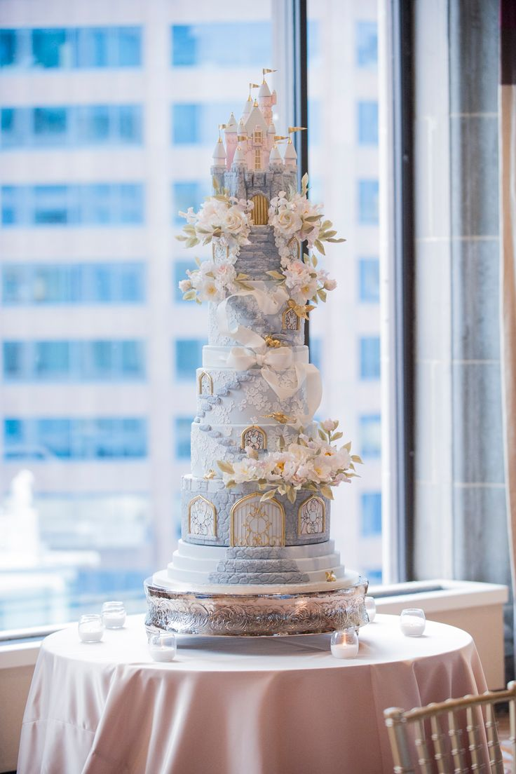 This amazing Disney-themed wedding cake even had a replica of Sleeping Beauty's castle as a topper!