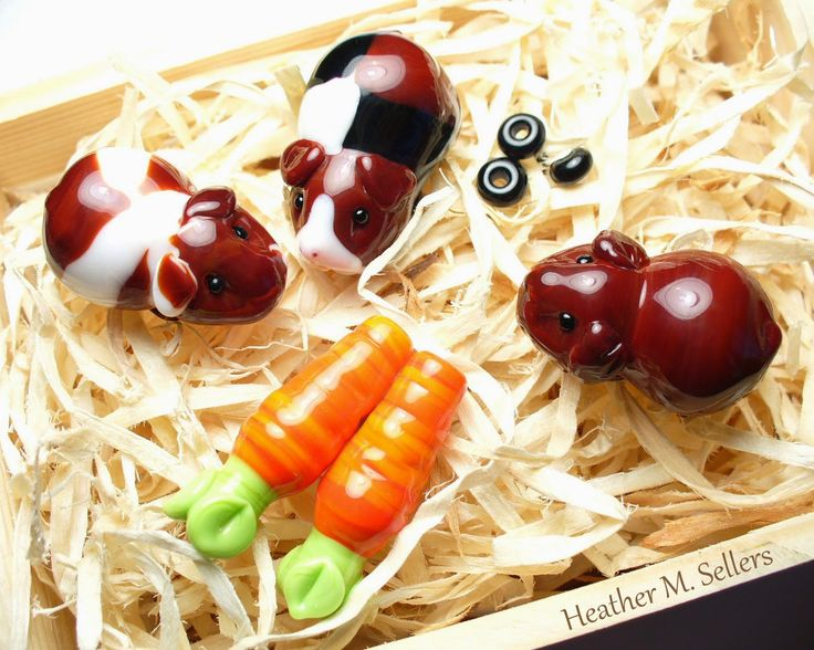 A crate full of guinea pigs by Heather Sellers.  Unique lampwork glass beads.