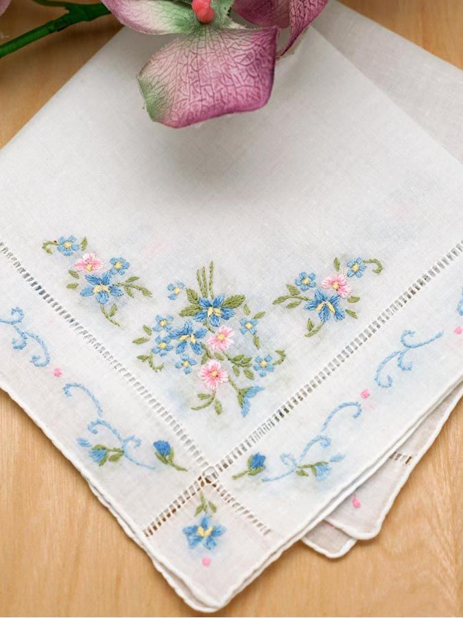 "Floral Forget-Me-Not Wedding Handkerchief This lovely wedding handkerchief has both pink and blue ""Forget-Me-Not"" flowers embroidered in all four corners. The design is absolutely gorgeous.  Forget-Me-Nots are a popular wedding flowers for many. These small wild flowers of both blue and pink and symbolize both love and hope. The handkerchief is 100% cotton and measures approx. 12"" x 12"" square. This is for a single handkerchief."