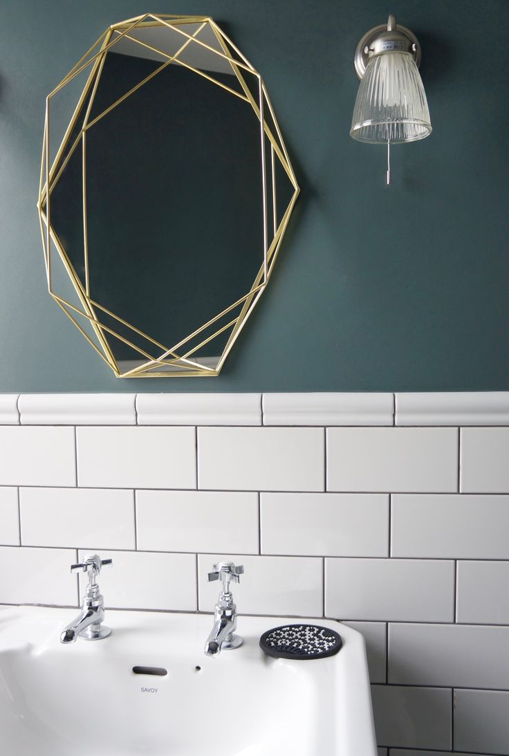 Inchyra blue walls and metro tiles in this east London bathroom - but what about that mirror! The contrasting elements create a very sleek, modern bathroom yet simple touches such as the Moorish style soap dish lends an element of colour and pattern.