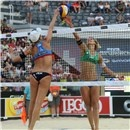 Jennifer Kessy (left) and Laura Ludwig compete for the ball at the net (FIVB, Rome)