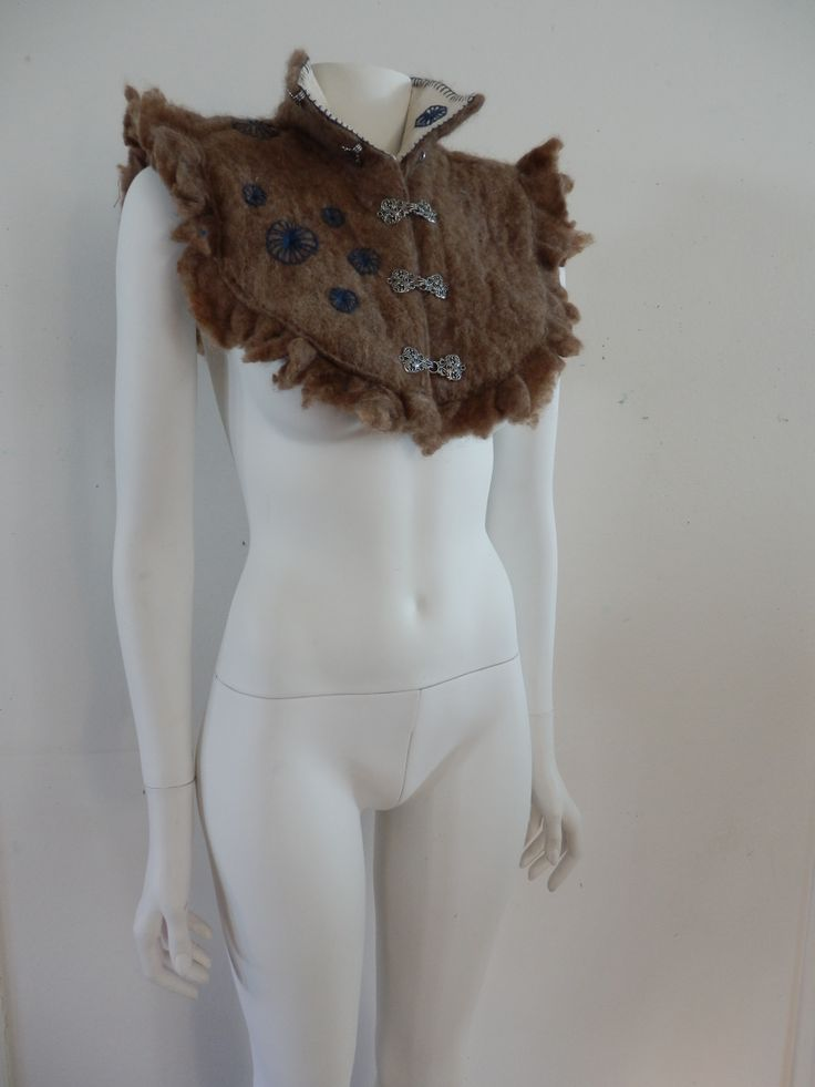Felted ruffle collar with blue embroidery and cotton lining.