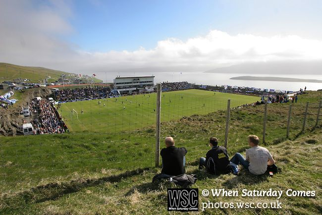 Faroe Islands 0 Scotland 2, 06/06/2007. European Championship Qualifier. Three Faroese fans watching the action from the hillside outside the ground as the Faroe Islands take on Scotland in a Euro 2008 group B qualifying match at the Svangaskard stadium in Toftir. The visitors won the match by 2 goals to nil to stay in contention for a place at the European football championships which were to be held in Switzerland and Austria in the Summer of 2008. It was the first time Scotland had won in…