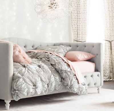 RH TEEN's Selby Tufted Daybed:Beauty sleep. Inspired by refined furnishings of the 19th century, our platform-style daybed's features graceful arches and an elegant rounded footboard with turned feet. Allover tufting completes the timeless design.
