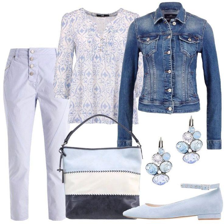 I+pantaloni+con+chiusura+con+quattro+bottoni+sono+in+cotone+color+azzurro+polvere.+La+stessa+tonalità+è+usata+per+la+stampa+dei+disegni+della+camicia+bianca+in+cotone.+La+giacca+di+jeans+è+blu+con+tasche+anteriori+e+chiusura+a+sei+bottoni.+La+borsa+a+mano,+in+finta+pelle,+ha+tre+righe+orizzontali+nei+colori+bianco,+blu+e+azzurro.+Le+ballerine+scamosciate+con+cinturino+alle+caviglie+sono+azzurro+polvere+come+i+cristalli+degli+orecchini+in+metallo,+leggermente+pendenti.