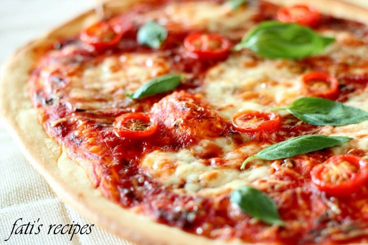 Now that I've reached my first university holiday of the year, I've taken out the time to post – as promised – my pizza base recipe (and a Margherita at that) :) If you reme…