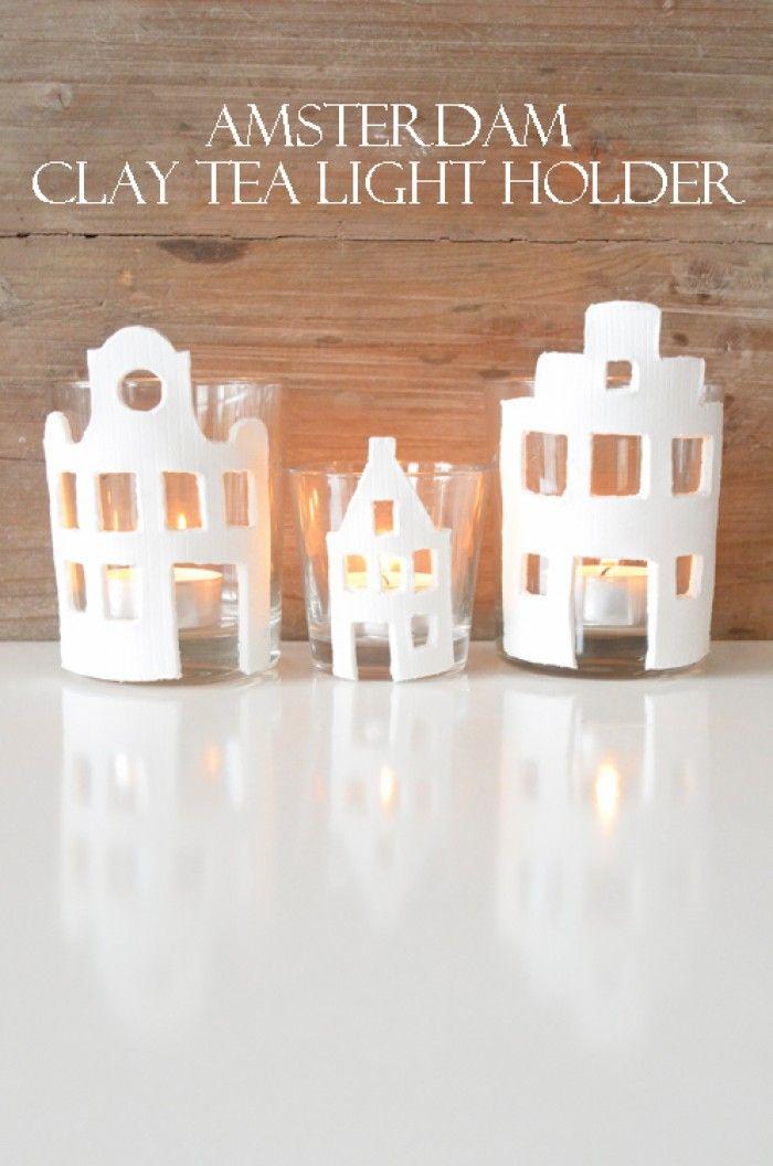 Thee licht houders met een klei huisjes, heel simpel om te maken.