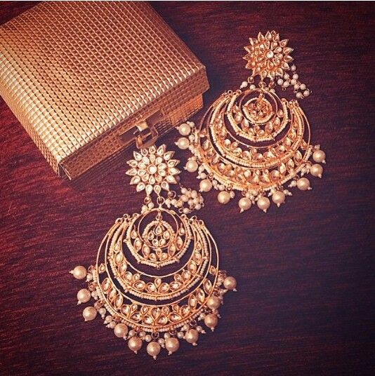 Amrapali bridal statement earrings. Gold and pearl earrings and clutch
