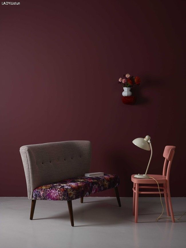 PLAY WITH DIFFERENT GLOSS LEVELS  The completely matte wall creates tranquility and depth, a great backdrop for items to be added -- such as the upholstered bench [floral] from Designers Guild, and a chair painted Super Blank in the color Butterfly.