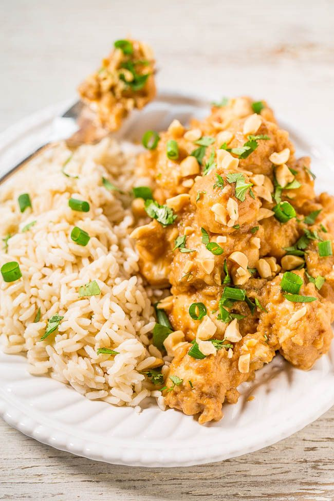 Slow Cooker Thai Peanut Chicken - The easiest peanut chicken ever and your slow cooker does all the work!! Topped with crunchy peanuts, cilantro, green onions, and the peanut sauce is irresistible!!