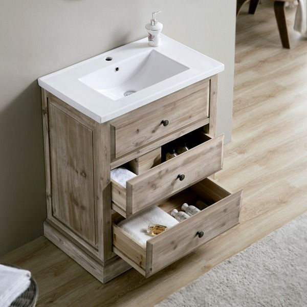 This rustic style bathroom vanity will be perfect for any small bathroom. The distressed driftwood finish gives the vanity a unique style. The ceramic sink top sits above two usable drawers to store y