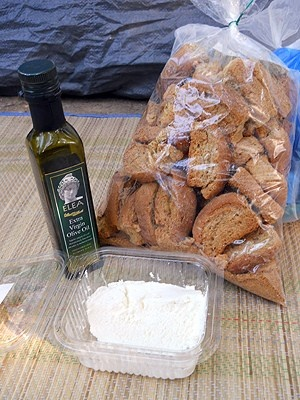 Greek products, virgin olive oil, wholemeal Creta rusks and fresh goat cheese - a complete meal in itself