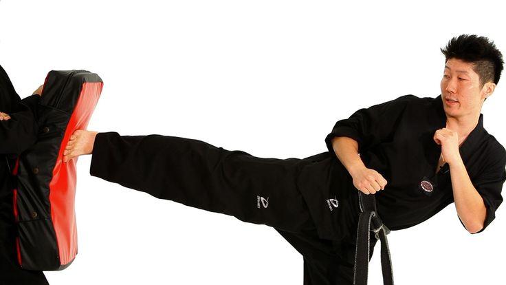 Watch more How to Do Taekwondo videos: http://www.howcast.com/videos/508730-How-to-Do-an-Axe-Kick-Taekwondo-Training Learn how to do a side kick from taekwon...
