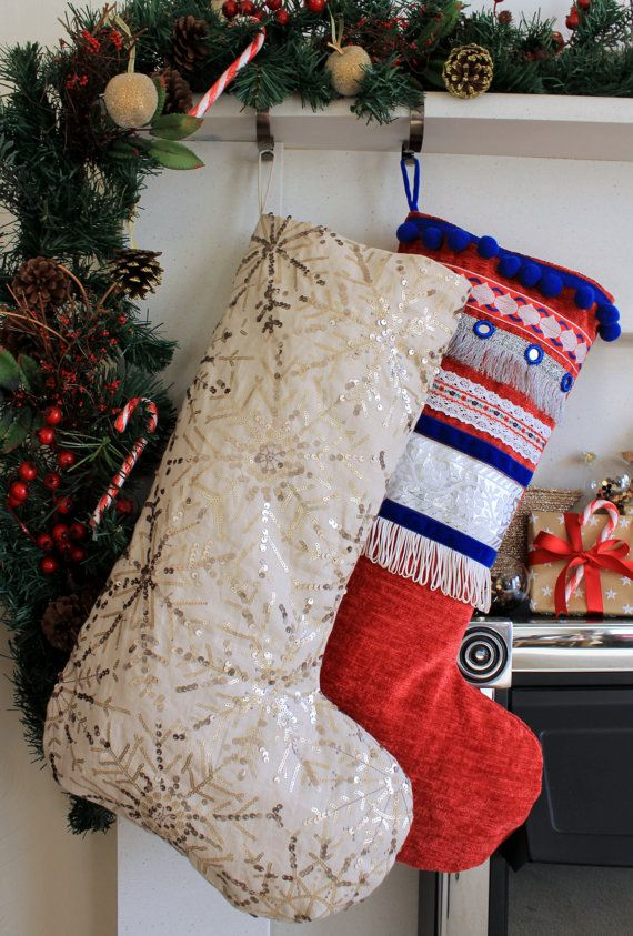 Festive stocking made from a sequin embroidered linen fabric. The fabric is a natural cream colour with gold sequins embellished on top in a snowflake design.  Fully lined with a beige cotton fabric and finished with a linen fabric hanging loop.  Length : 52cm Width : 22cm (across cuff)  34cm (across foot)