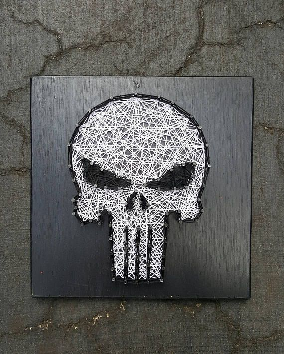 The Punished string art by Stressed Out Studios Hey, I found this really awesome Etsy listing at https://www.etsy.com/listing/511628858/the-punisher-skull-string-art-made-to