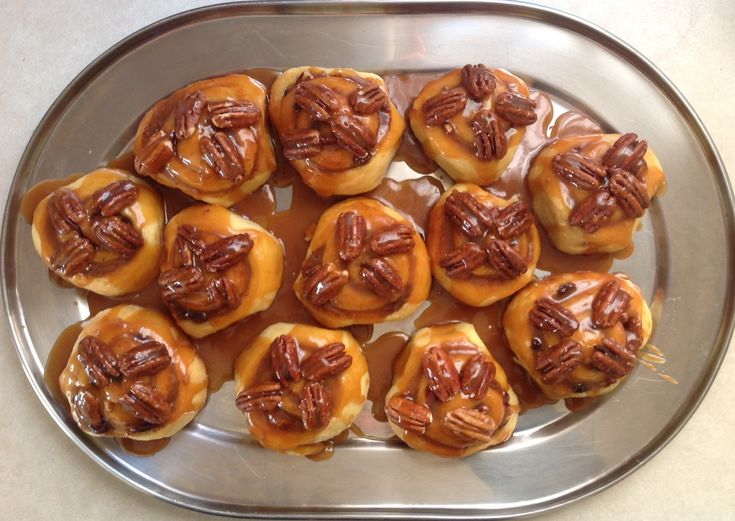A brioche dough filled with cinnamon, pecans and boozy raisins, topped off with a homemade caramel sauce. Double the recipe; you'll want more than 12.