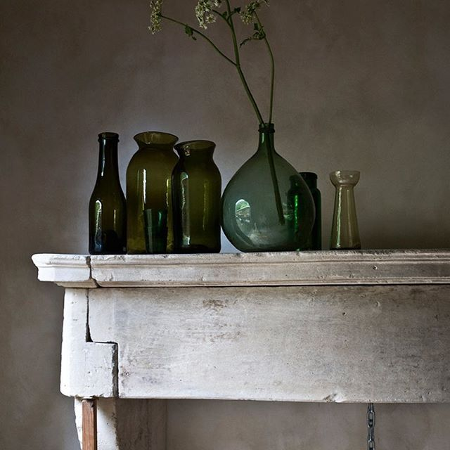 Sandstone fire place, castle, antique, vintage, interior, green glass bottles, design, Piet Jonker