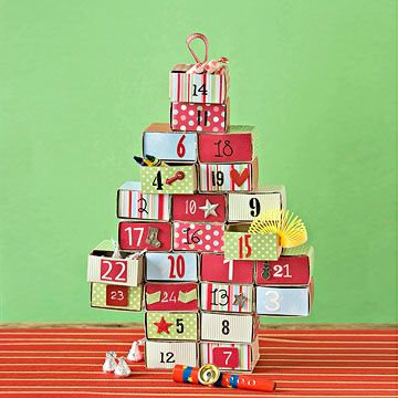 Stacked Advent Calendar - A fun treat for kids and adults, this Advent calendar is a cinch to make with inexpensive matchboxes and spare supplies. Fill with fun trinkets, candy, and notes to make the days leading up to Christmas more enchanting.