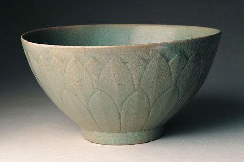 Korea, Koryo period (918-1392), 12th century The exterior of this bowl is incised with two layers of lotus petals, a flower that was both symbolic of Buddhism and a popular decorative motif on East Asian pottery