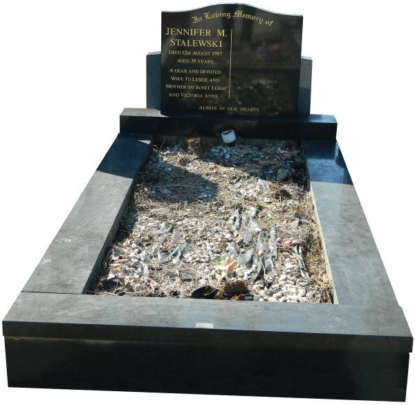 Polished, Single Serpentine With Centre Filled style, Cemetery Memorials Brisbane full single memorial created in Dark Grey Indian Granite, with inscribed gold lettering for The Stalewski Family and installed in the 3B section of the Mt. Gravatt Cemetery. #fullmonuments #cemeterymonumentsbrisbane #memorialmonumentsbrisbane #cemeterymemorialsbrisbane #monumentalmasonsbrisbane #indiangranitecemeterymemorials
