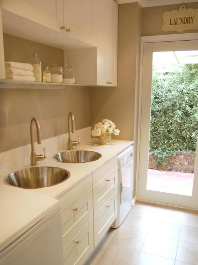 This dreamy laundry room almost looks like a spa.