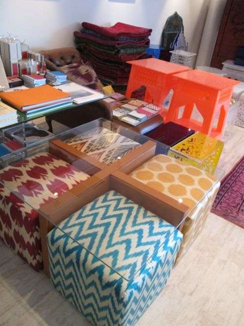 I like the ottomans under the coffee table for extra storage & seating.
