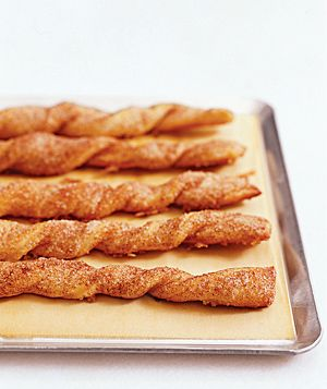 Cinnamon Twists - made from pizza dough, 1/2 cup sugar, 2t cinnamon and butter - bake in oven. This looks sooo yummy