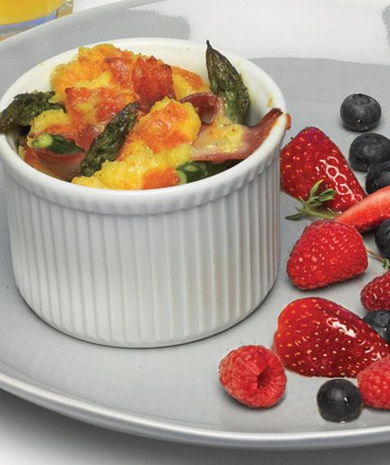 Hmmm....this looks like a wonderful mother's day breakfast. Baked eggs, with asparagus, ham and gruyere from realsimple.com...hint hint hint...