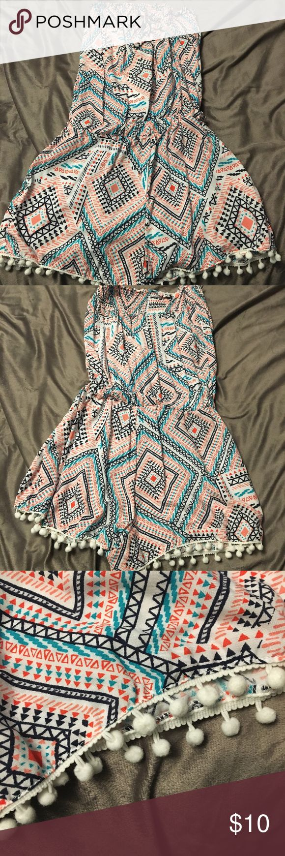 Rue 21 sleeveless romper Sleeveless romper with an Aztec design! Cute white balls on the bottom, has a tie at the top that you could tie around your neck! Rue 21 Dresses